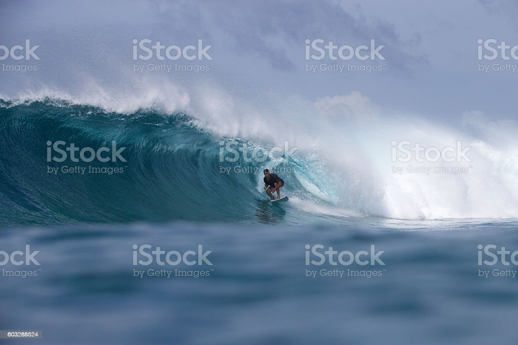 Surfer gets a barrel on a big wave stock photo