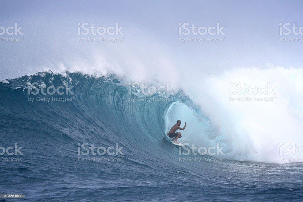 Surfer gets a big barrel stock photo