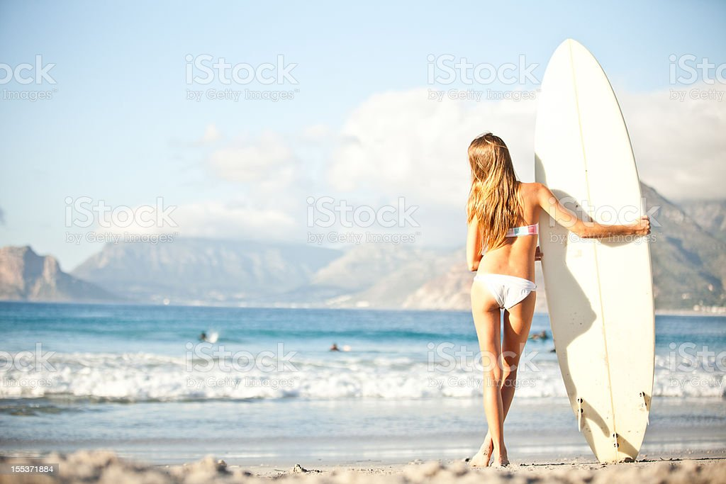 Surfer girl at the beach royalty-free stock photo