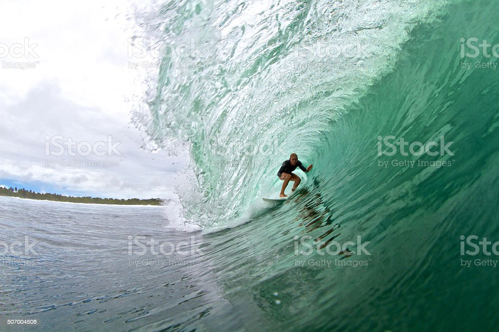 Surfer girl in a big barrel stock photo