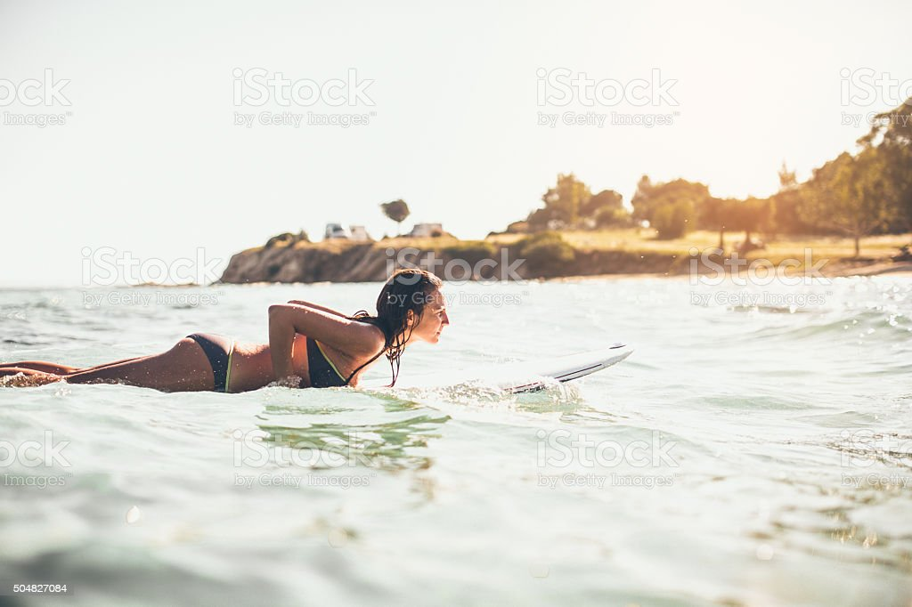 Surfer girl in action stock photo