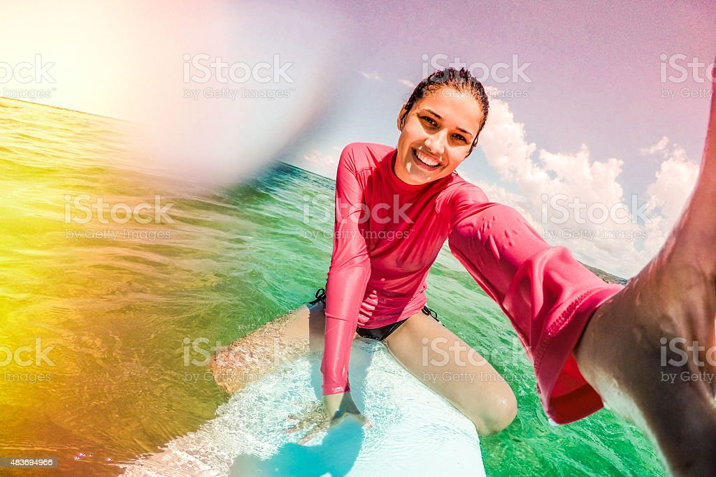 Surfer girl making a selfie stock photo