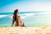 Girl is relaxing on the beach in summer.