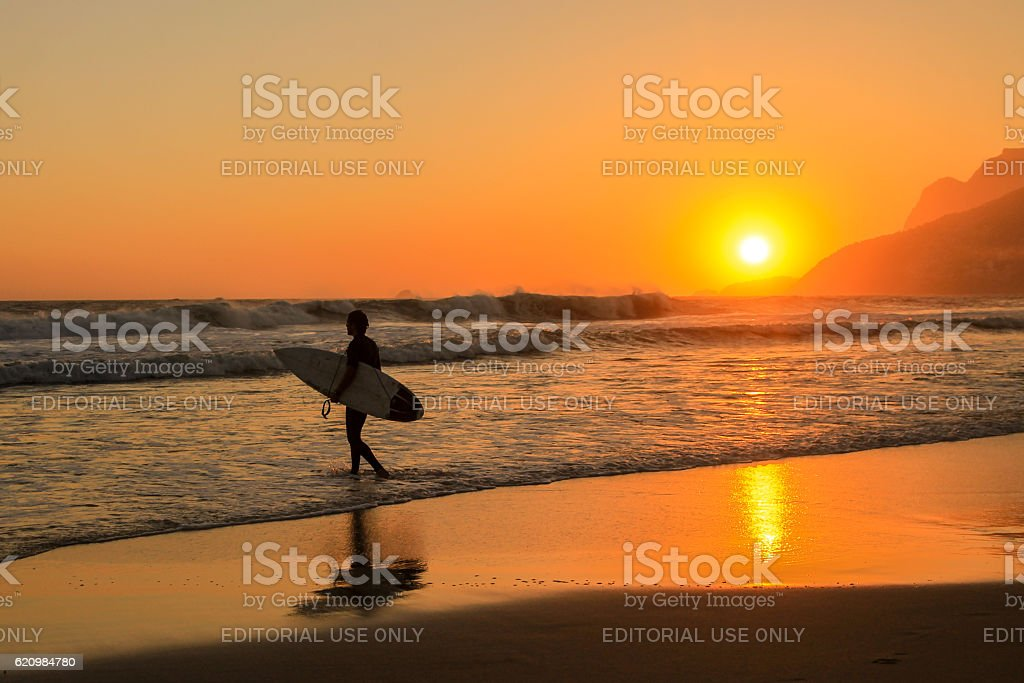 Surfer going to the sea stock photo