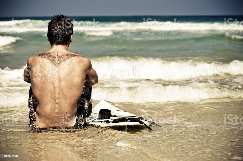 Surfer guy waiting for a wave stock photo