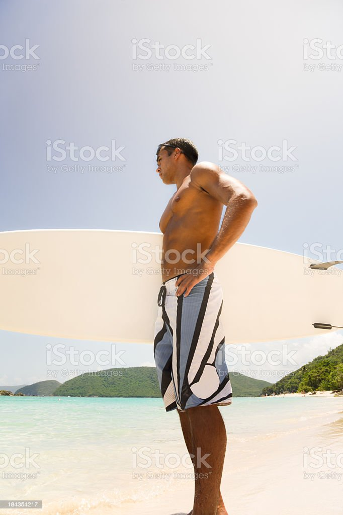 surfer holding surfboard and waiting for a perfect wave royalty-free stock photo