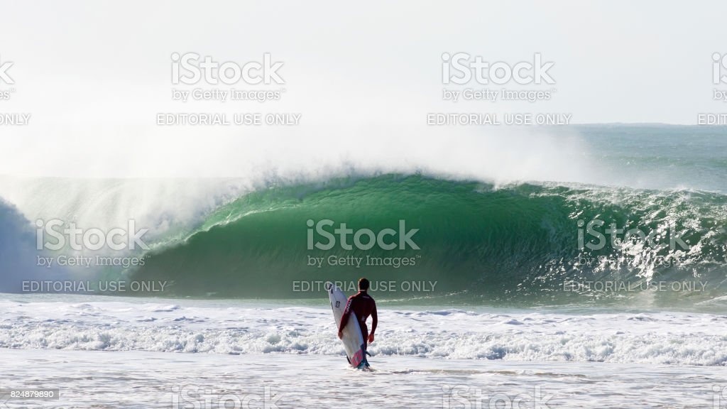 Surfer in Front of a Big Wave stock photo