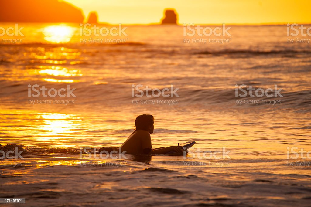 Surfer in the evening sun on Playa Conchal, Costa Rica royalty-free stock photo
