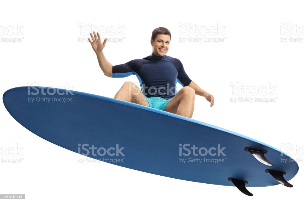 Surfer jumping with a surfboard royalty-free stock photo