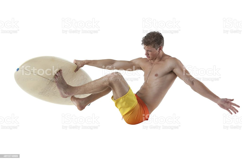 Surfer jumping with his surfboard royalty-free stock photo