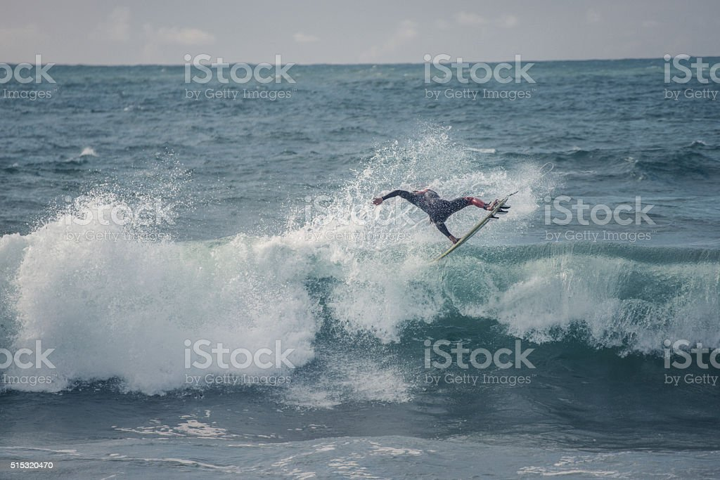 surfer jumps stock photo