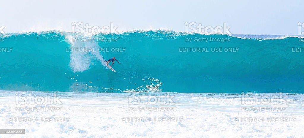 Surfer Kelly Slater Surfing Bonzai Pipeline in Hawaii stock photo