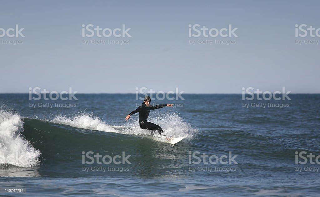 surfer making a forehand royalty-free stock photo