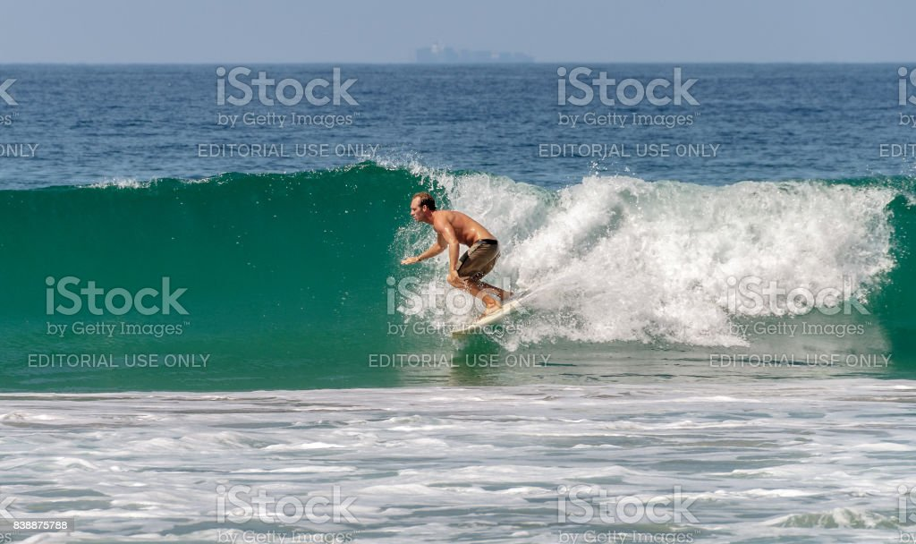 Surfer man riding a wave in Malibu beach, California, USA. stock photo