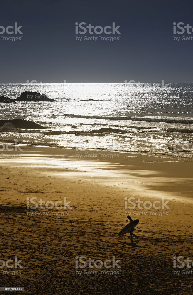 Surfer on beach in silhouette royalty-free stock photo