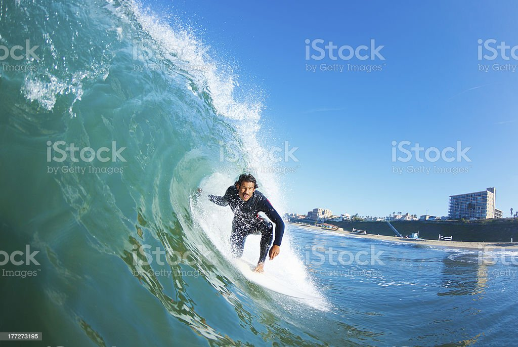 Surfer on Blue Ocean Wave stock photo