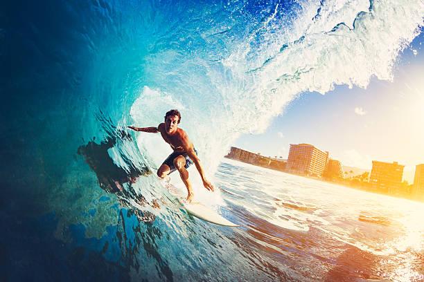 surfer on blue ocean wave - экстремальные виды спорта стоковые фото и изображения