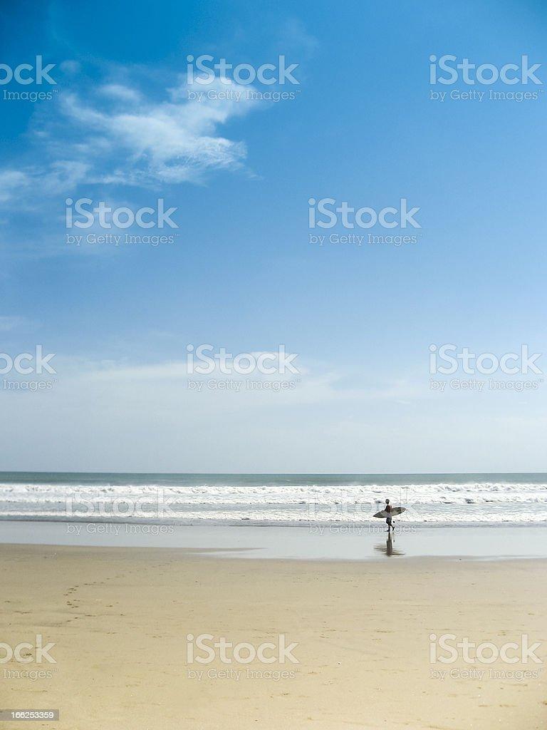 surfer on kuta beach bali indonesia royalty-free stock photo