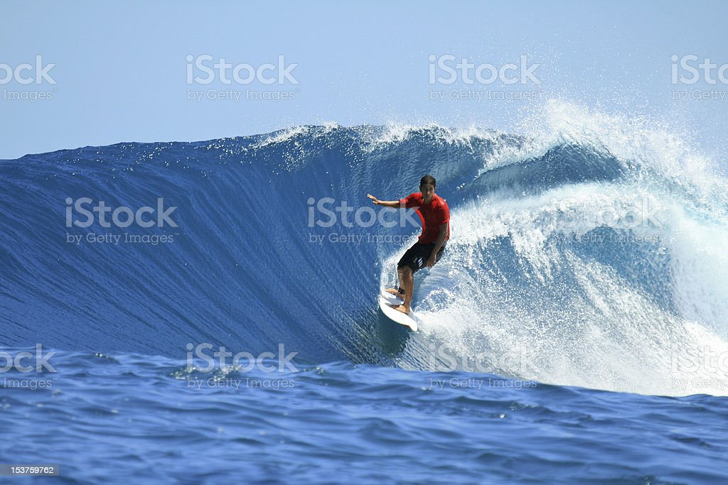 Surfer on perfect blue wave, Mentawai Islands, Indonesia stock photo