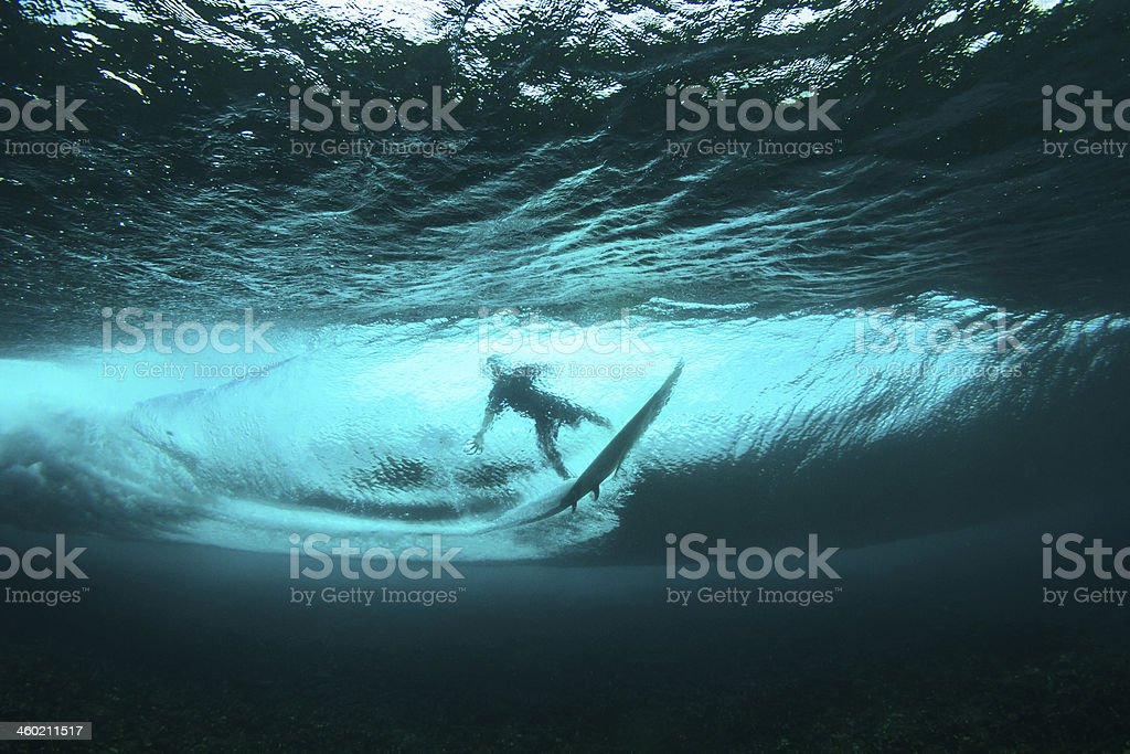 Surfer on tropical wave underwater vision stock photo