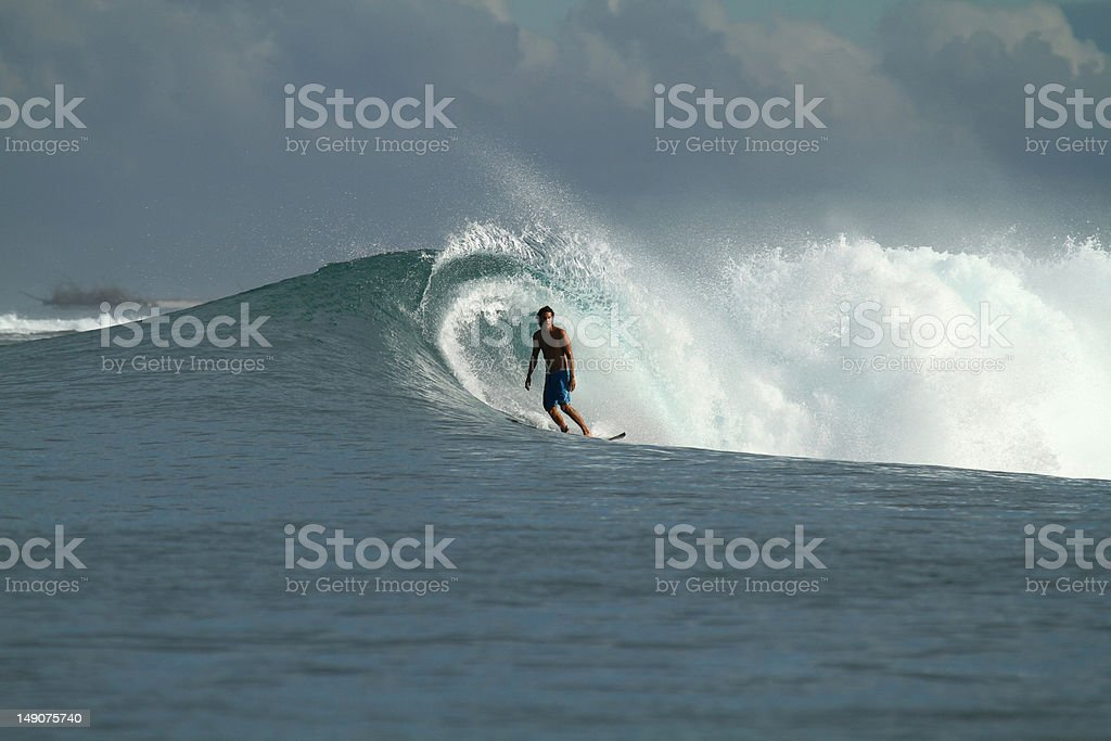 Surfer on wave, Indonesia stock photo