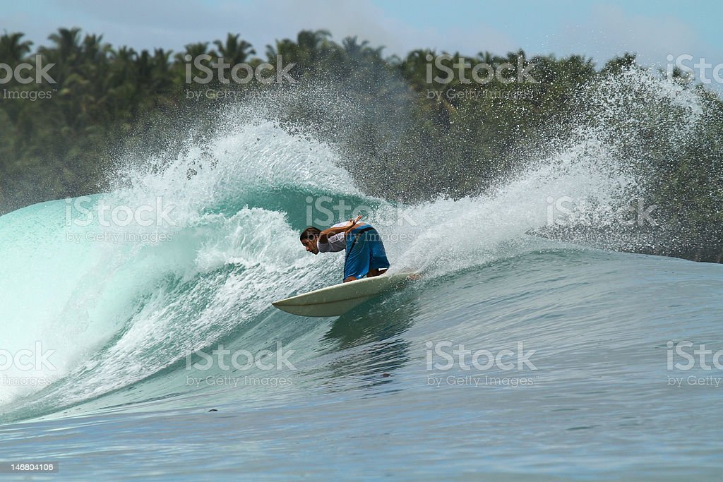 Surfer on wave, Mentawai Islands, Indonesia stock photo