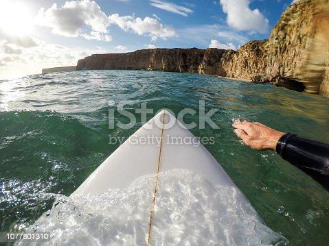 Surfer paddling point of view