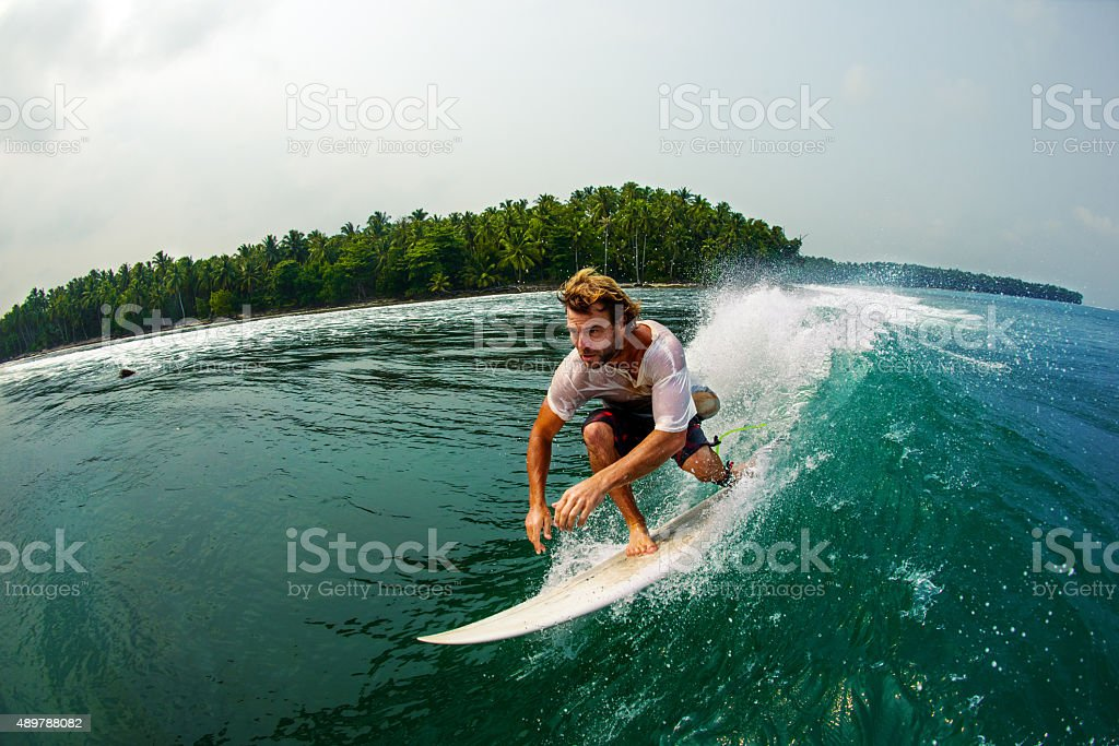 Surfer Races Along A Perfect Wave stock photo