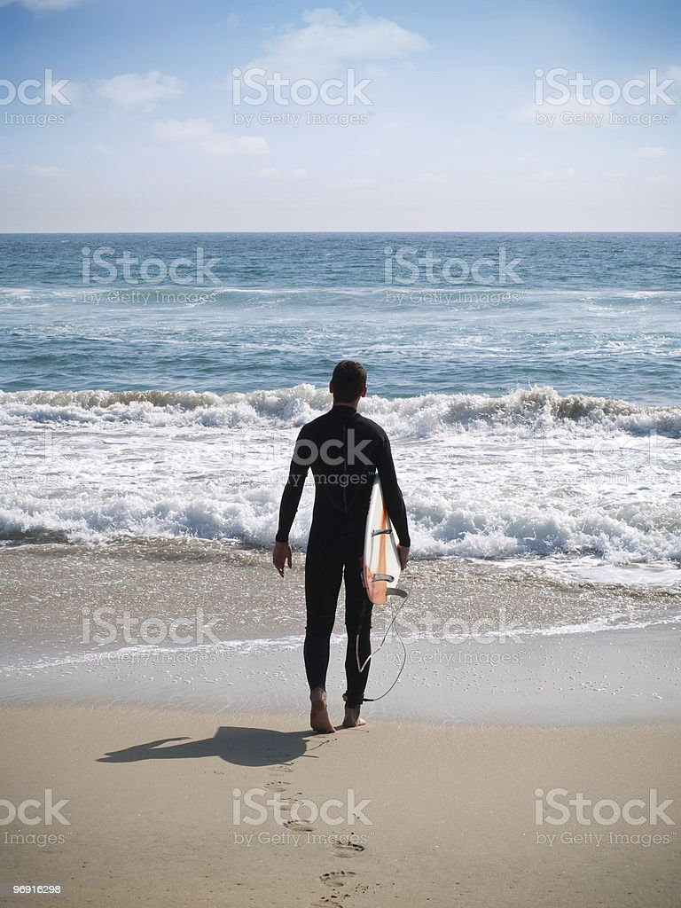 Surfer ready to surf royalty-free stock photo