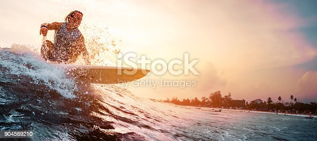 istock Surfer rides the ocean wave 904569210