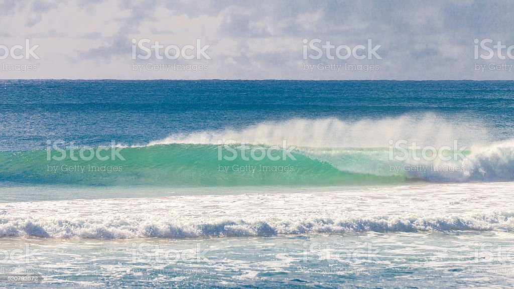 Surfer riding a beautiful wave in Australia stock photo