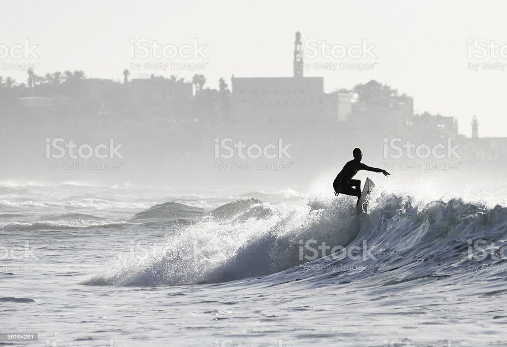 Surfer riding a wave stock photo