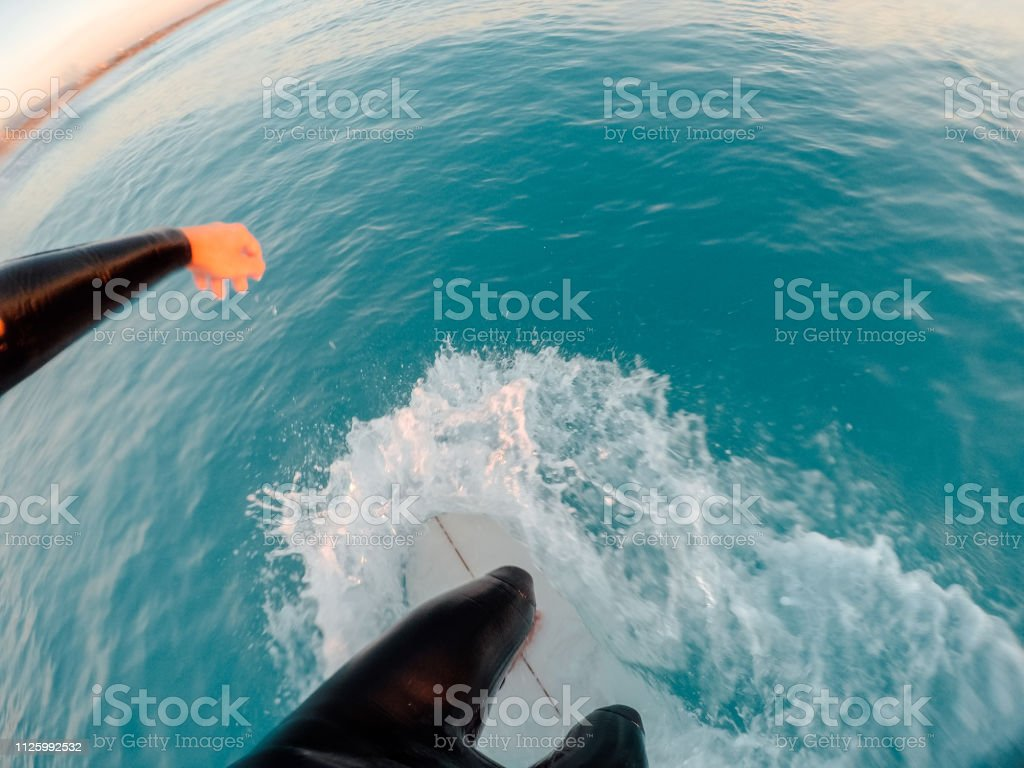 Surfer riding a wave point of view