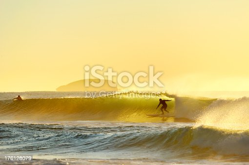 istock Surfer riding incoming wave in the morning 176128079