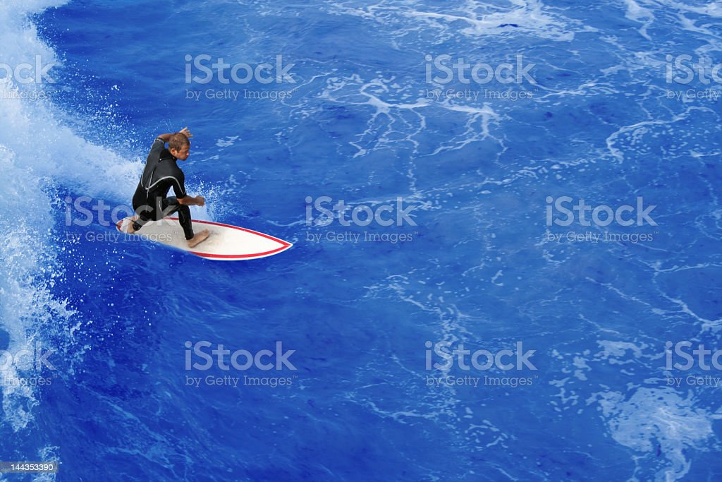 Surfer riding the perfect  wave stock photo