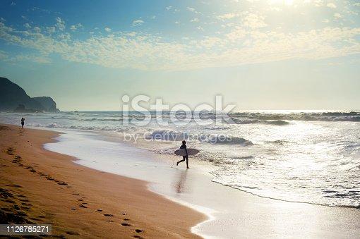 Surfer at the Atlanctic ocean beach. Algarve, Portugal