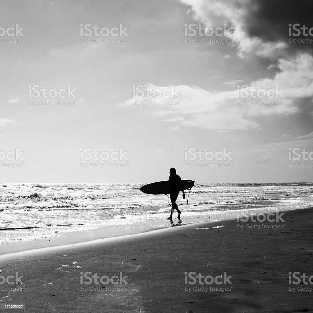 Surfer scoping the surf royalty-free stock photo