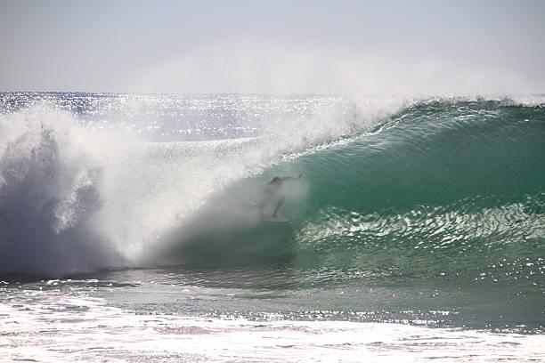 Surfer tube stock photo