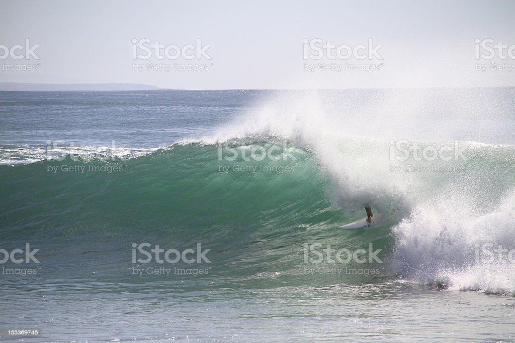 Surfer tube riding stock photo