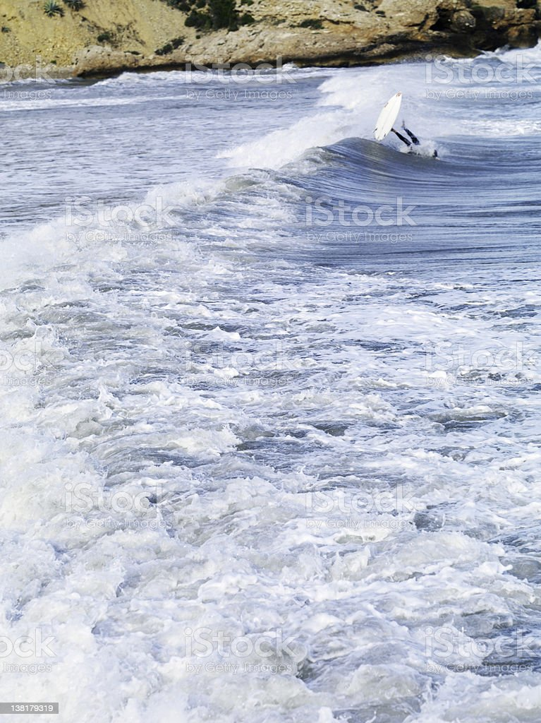 Surfer underboard royalty-free stock photo