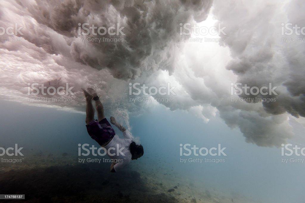 Surfer underwater stock photo