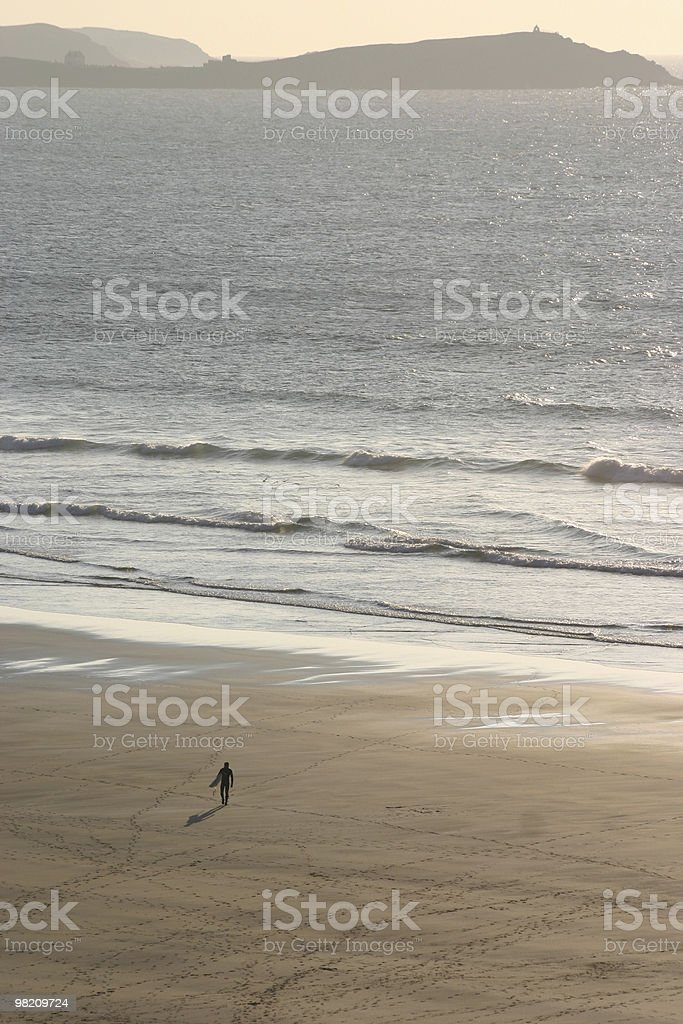 Surfer walking over the beach royalty-free stock photo