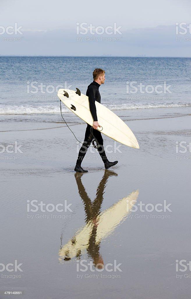Surfer walking stock photo