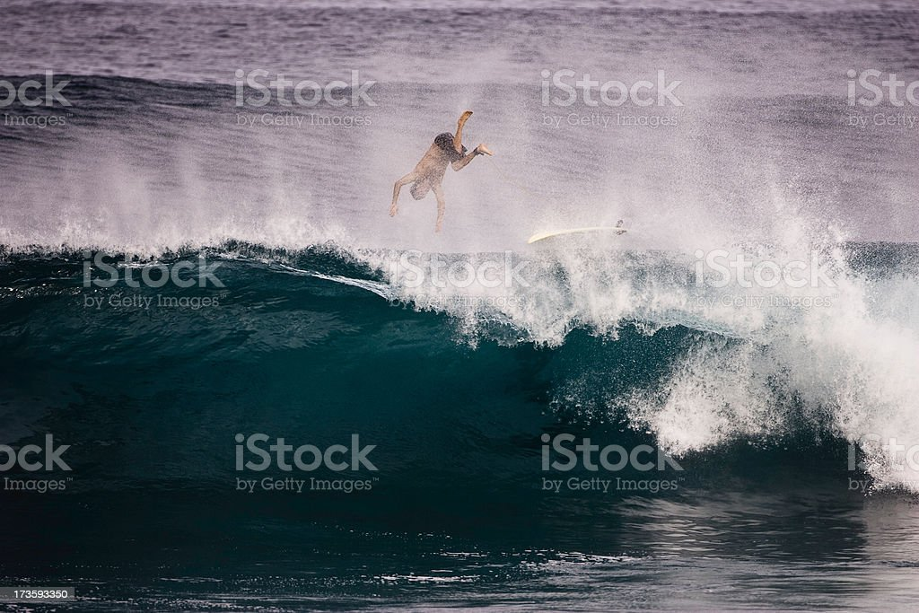 Surfer wiping out stock photo