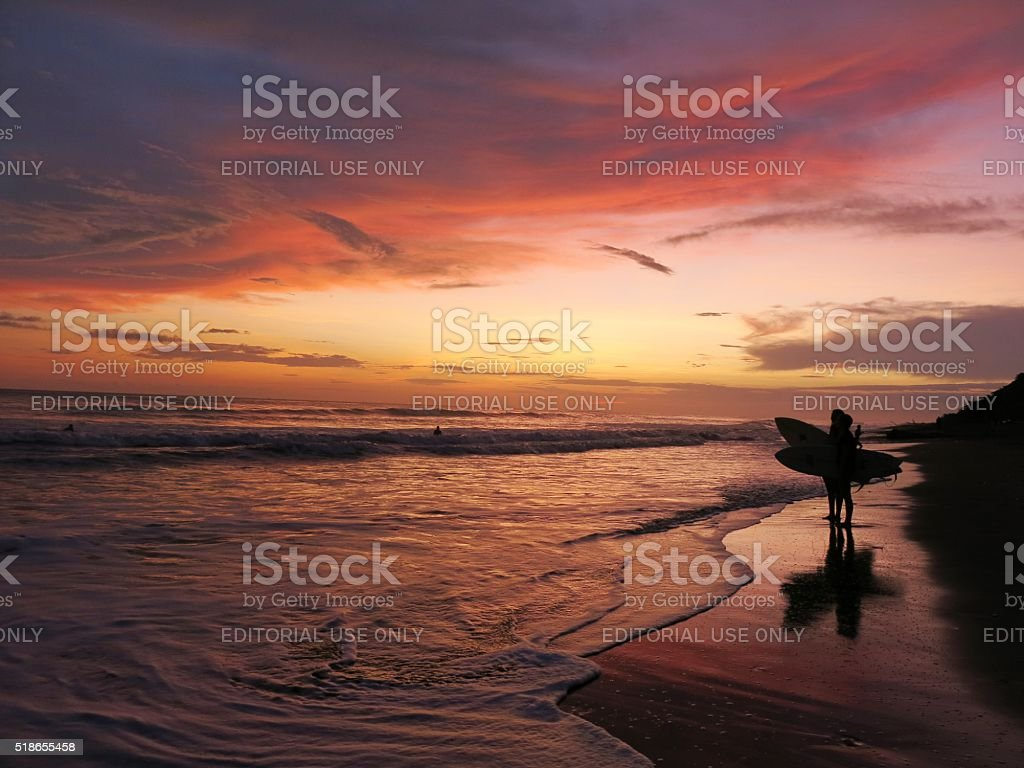 surfers after surfing while sunset in Costa Rica stock photo