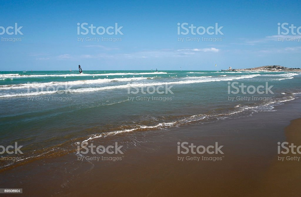 surfers and beach in Italy at summer time royalty-free stock photo