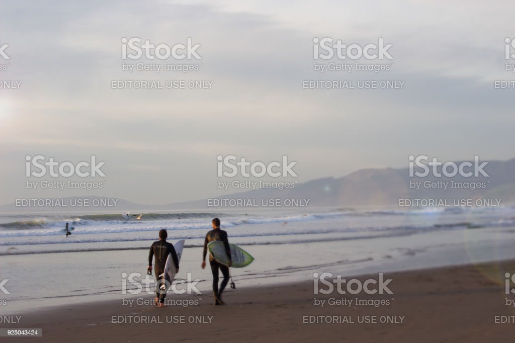 Surfers at Beach stock photo