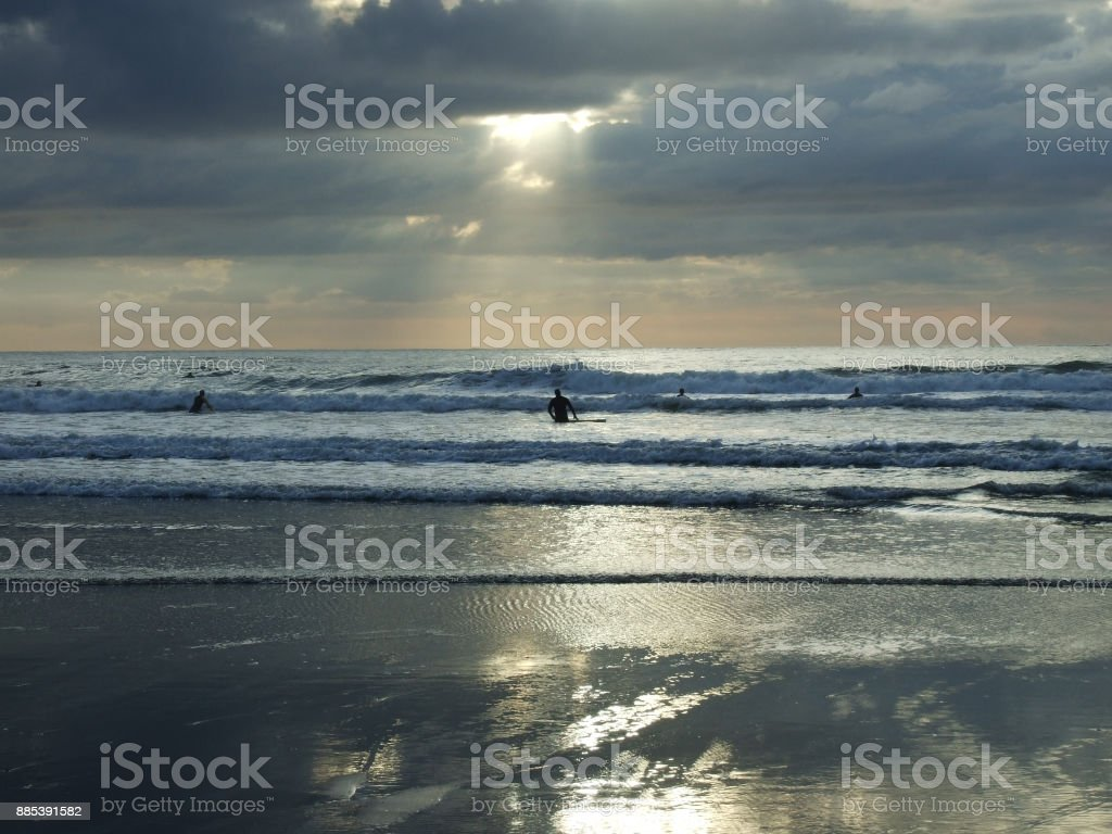 Surfers at Croyde Bay stock photo