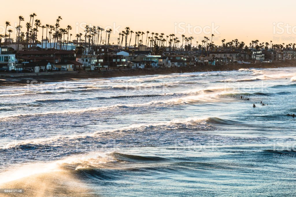 Surfers at Dawn in Oceanside, California stock photo