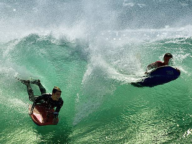 Surfers At The Wedge stock photo